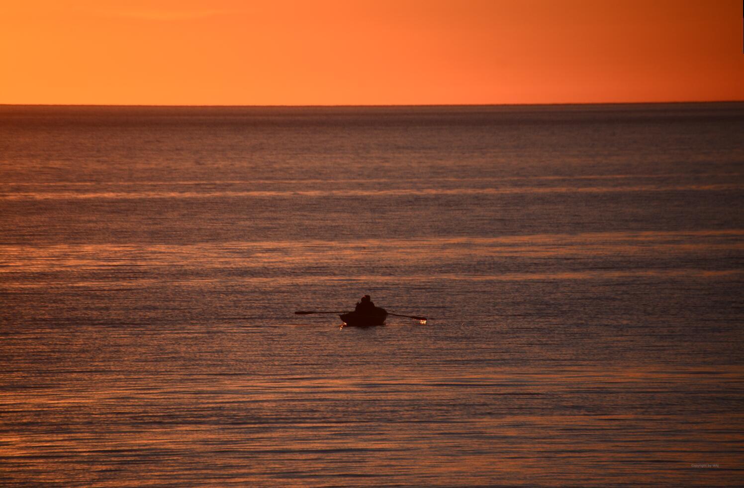 Angler im letzten Licht