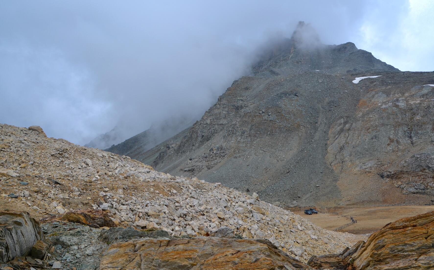 Wetterfront über'm Plateau Colle Sommeiller mit der italienisch-französischen Grenzlinie